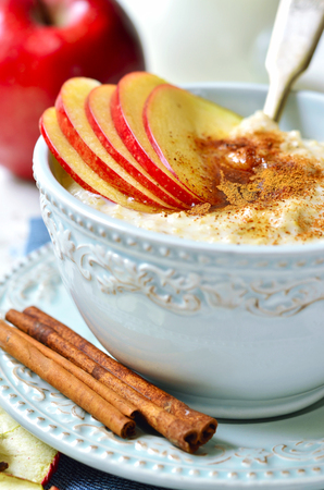apple and honey: Oat porridge with apple,honey and cinnamon for a breakfast.