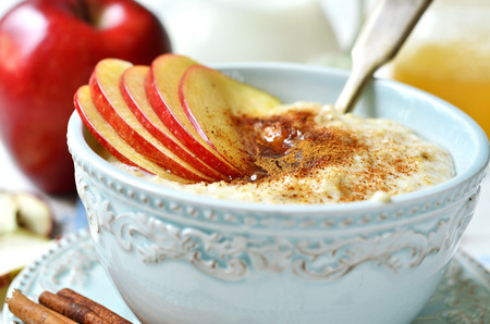 stick of cinnamon: Oat porridge with apple, honey and cinnamon for a breakfast.