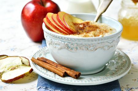 apple and honey: Oat porridge with apple, honey and cinnamon for a breakfast.