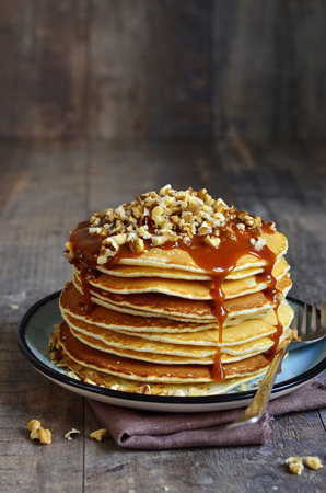 Pancakes with walnut and caramel for a breakfast.