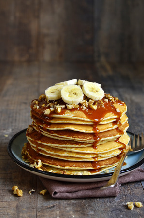 Pancakes with banana,walnut and caramel for a breakfast.