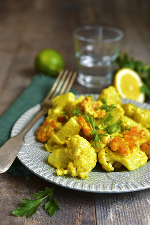 vegetable curry: Vegetable curry with cauliflower in a cream on rustic background.