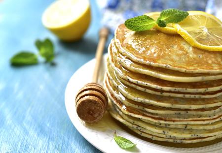 Homemade poppy seed lemon pancakes with honey.