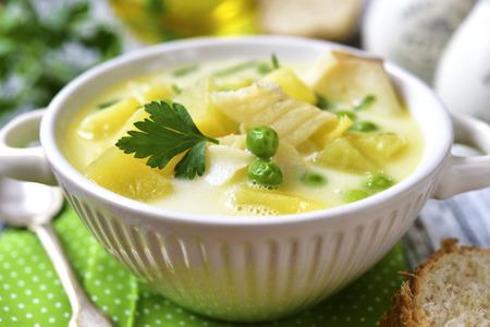 potato cod: Chowder with potato,cod and green pea on rustic background.