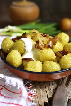 polish lithuanian: Potato dumplings - traditional dish of belorussian and polish cuisine on rustic background. Stock Photo