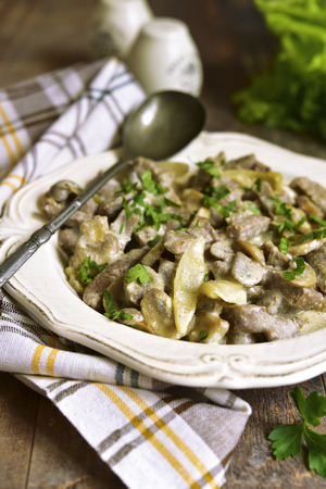 beef stroganoff: Beef stroganoff with mushrooms in a vintage plate. Stock Photo