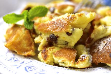 Kaiserschmarrn - traditional austrian pancake dessert with raisins.