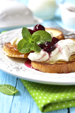toast: French toasts with ricotta and cherry syrup.