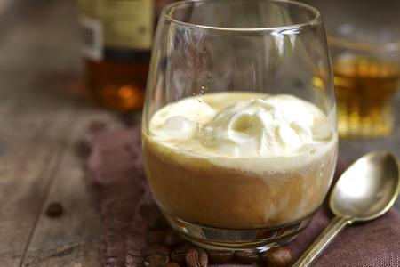 amaretto: Affogato - traditional italian coffee dessert on a rustic background. Stock Photo