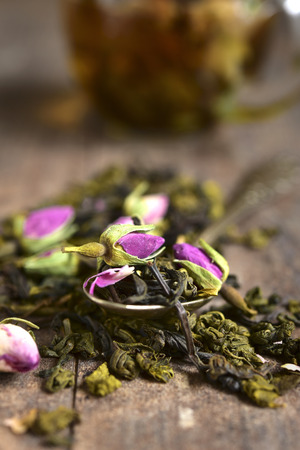 Mix of the tea with rose on a wooden table.Rustic style.