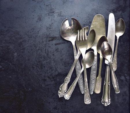 silverware: Vintage silverware on a black background.Top view. Stock Photo