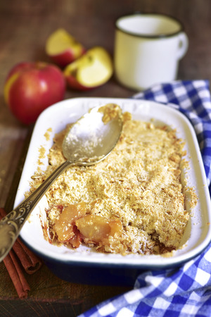 apple crumble: Apple crumble - traditional english dessert on a rustic wooden background.