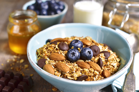 Granola with chocolate and almond - healthy breakfast concept.Rustic style.