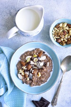 Chocolate oat porridge with nuts - healthy breakfast.Top view.