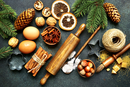 Rustic christmas baking background with ingredients for making cookies or cake over dark emerald slate,stone or metal background.Top view . 写真素材
