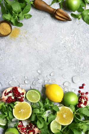 Food background with ingredients for making citrus lemonade on a grey slate, stone or concre table.Top view with copy space. Stock Photo