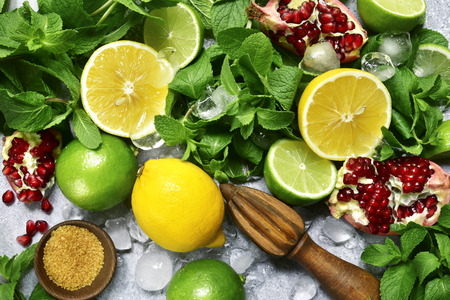 Food background with ingredients for making citrus lemonade on a grey slate, stone or concre table.Top view .