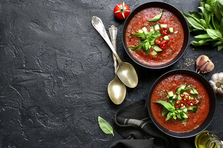 Traditional spanish cold tomato soup. Top view with copy space.
