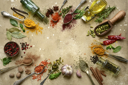 Assortment of natural spices on a spoons over light slate, stone or concrete background. Top view with copy space. Stock Photo