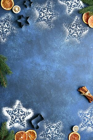 Christmas baking background with candied fruits and winter spices on a dark blue slate, atone or concrete table. Top view with copy space. Stockfoto
