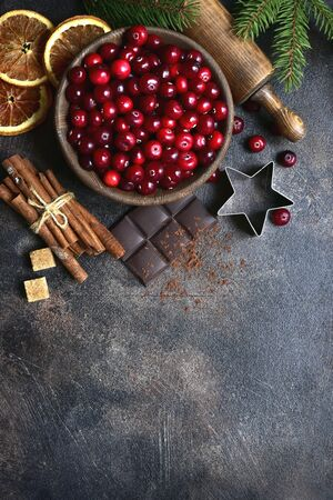 Culinary background with christmas winter spices and ingredients for baking on a dark slate, stone or concrete table. Top view with copy space. Stok Fotoğraf