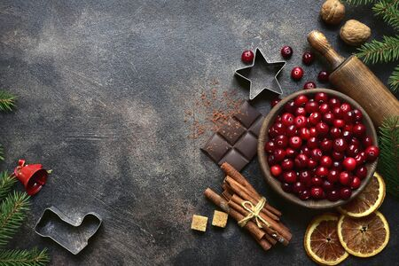 Culinary background with christmas winter spices and ingredients for baking on a dark slate, stone or concrete table. Top view with copy space. Standard-Bild - 133235977
