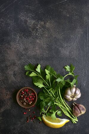 Assortment of spices on a dark slate, stone, concrete or metal background. Top view with copy space.