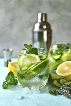 Cucumber and lemon refreshing drink with mint in a glasses.  Stock fotó