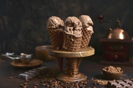 Homemade chocolate coffee ice cream on a dark rustic background.