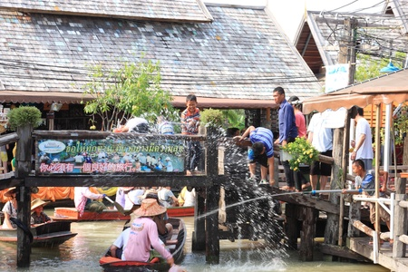 13 15 years: Pattaya- APRIL 15: Songkran Festival is celebrated in Thailand as the traditional New Years Day from 13 to 15 April by throwing water at each other, on 15 April 2011 in Pattaya (boat market)