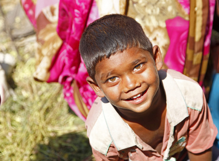 neighborly: GAYA, INDIA - MARCH 19: Indian boy smiles and looking camera in a village in Bihar, India on March 19, 2015.