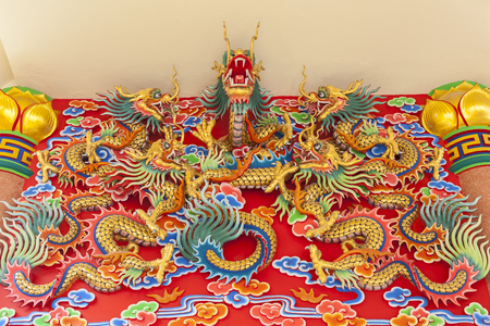 fengshui: Five Chinese Dragons statue on temple wall in Thailand Stock Photo