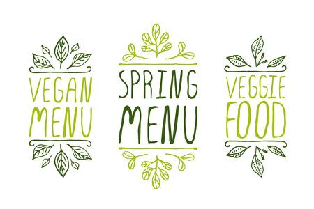 Hand-geschetst typografische elementen op een witte achtergrond. Veganistisch menu. Menu voorjaar. Vegetarisch eten. Restaurant labels. Geschikt voor advertenties, uithangborden, menu en web banner ontwerpen