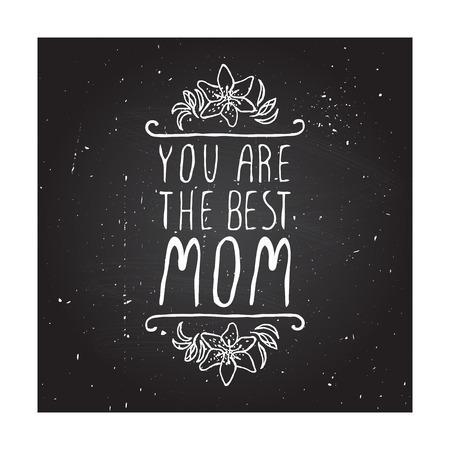 母亲节贺卡与百合花和处理元素在黑板的背景。您是最好的妈妈