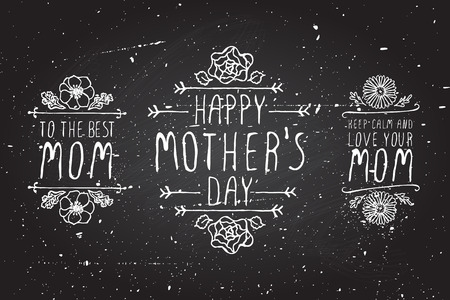 Happy mothers day handlettering elements with flowers on chalkboard background
