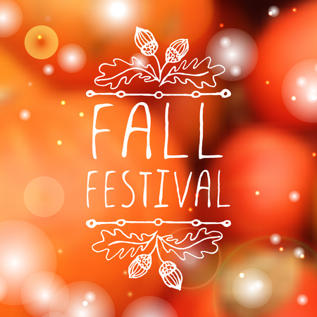 Fall festival. Hand-sketched typographic element with acorns on blurred background. Vettoriali