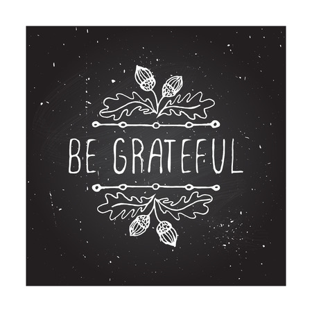 Be grateful. Hand sketched graphic vector element with acorns and text on chalkboard background. Thanksgiving design.