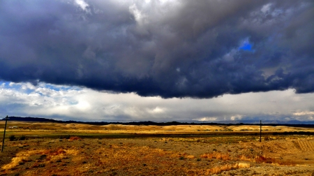 Dramatic storm clouds over endless Wilderness in countryside landscape, xinjiang, China