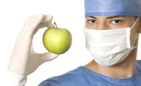 plastic surgeon: doctor holding a green apple