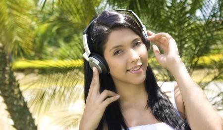 woman listening music outside photo
