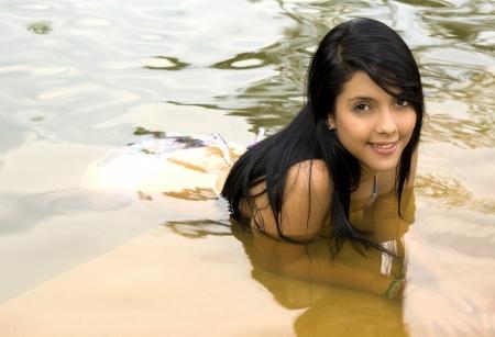 swimmingpool: woman relaxing at the pool