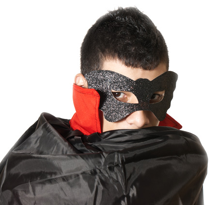 trick or treating: young man with mask and cape