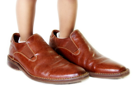 kid with dad�s shoes  photo