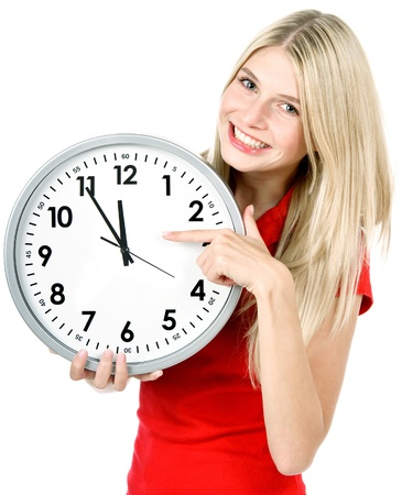 time concept  five to twelve  young beautiful woman holding big clock photo