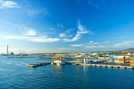 view of container port with beautiful blue sky  Mediterranean sea, Civitavecchia, Italy