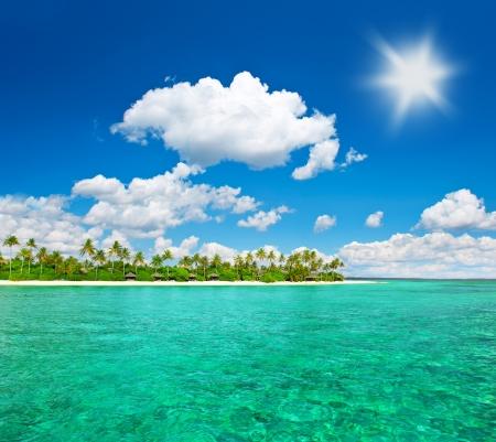 tropical island beach with cloudy blue sky  island of maldives photo