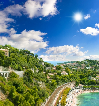 villefranche sur mer: beautiful coastline of french riviera with blue cloudy sky. view of luxury resort and bay of Cote dAzur near Nice
