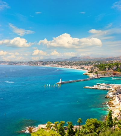 mediterranean sea: view of mediterranean resort, Nice, Cote dAzur, France. french riviera. turquoise sea and perfect sunny blue sky