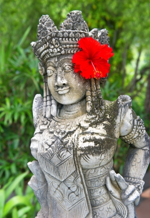 traditional female balinese statue outdoors photo