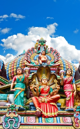 mariamman: Detail of Sri Mariamman temple in Singapore over beautiful blue sky. hindu temple